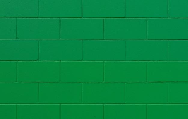 Textura e fundo de parede de tijolo pintado verde
