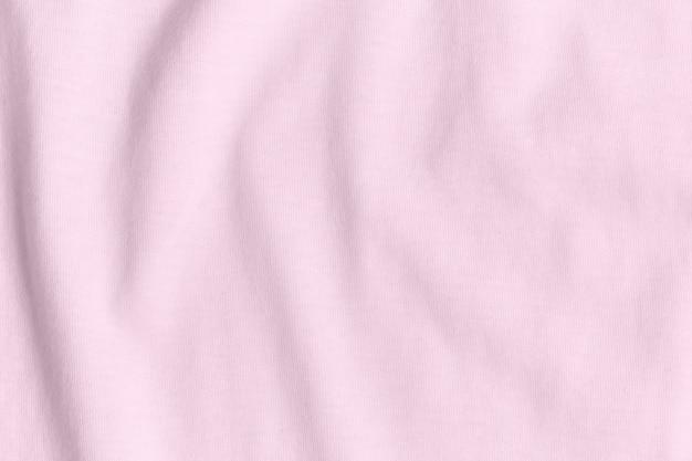 Textura e fundo de tecido rosa amassado.