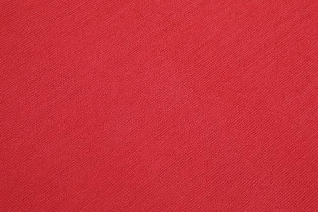 Textura elegante do tapete vermelho cor de vinho do close up, fundo de luxo sem costura