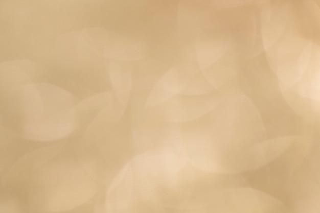 Textura embaçada de fundo com glitter dourado