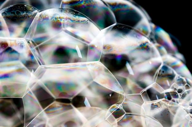 Textura ensaboada branca da espuma do fundo abstrato. espuma de xampu com bolhas