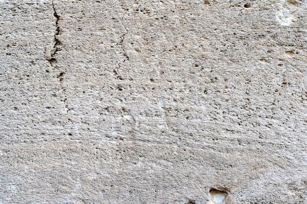 Textura feita de imagem em close-up da superfície da rocha da concha branca e cinza