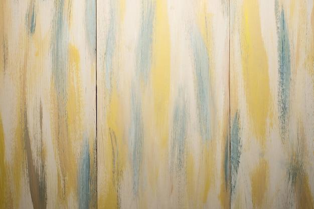 Textura. fundo. brown pintou a textura da placa de madeira com tons de amarelos e verdes.