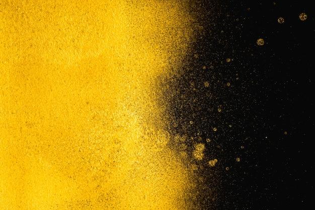Textura granulada abstrata dourada no fundo preto