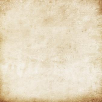 Textura grunge marrom em branco antiga da página retro áspera de papel bege