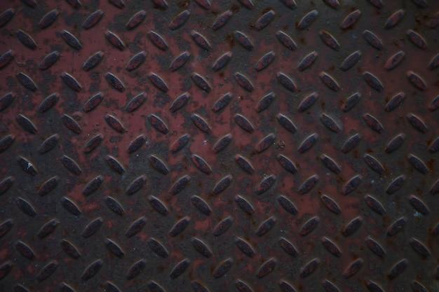Textura industrial de ferro corrugado para pisos. fundo de placa de diamante de metal grunge. espaço de direitos autorais para o site