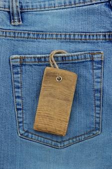 Textura jeans azul e etiqueta de preço