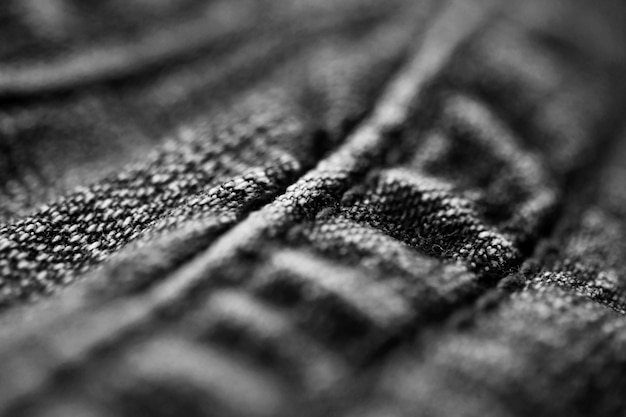 Textura jeans jeans close-up, foco em apenas um ponto, papel de parede de fundo manchado suave