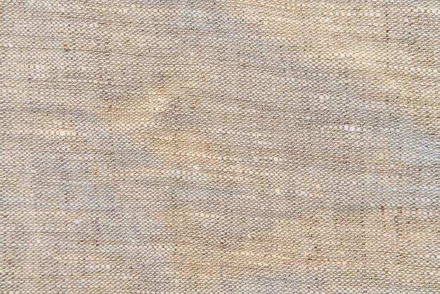 Textura leve de linho natural para o fundo. textura de linho de tecido natural para o projeto. pano de saco texturizado.