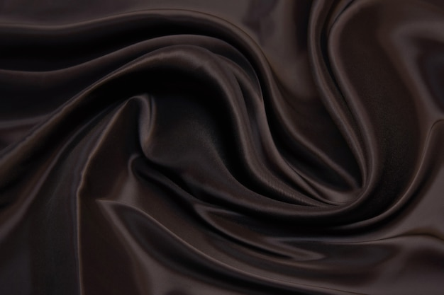 Textura lisa e elegante de seda marrom ou tecido de cetim luxuoso
