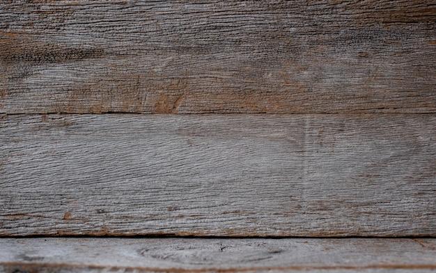 Textura listrada de madeira velha, conceito do fundo