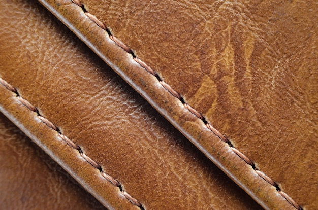 Textura marrom de pele natural com costuras