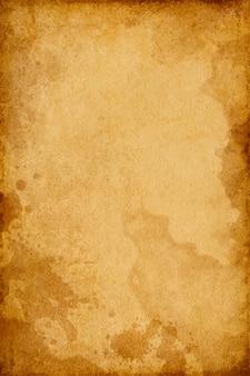 Textura marrom do grunge do velho papel vintage em pontos com espaço para texto