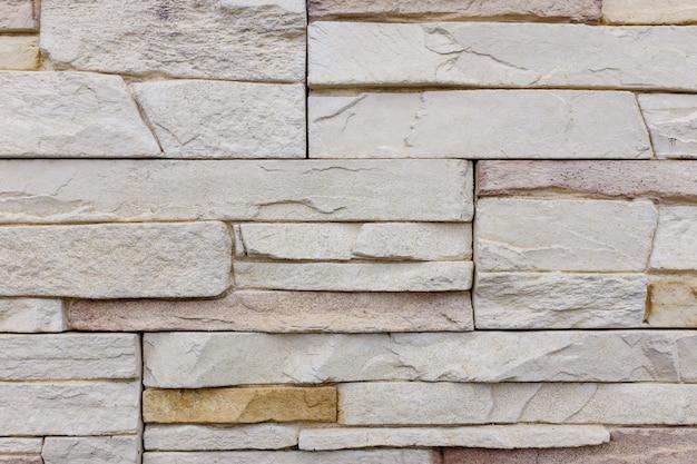 Textura marrom velha da parede de tijolo do teste padrão da parede de tijolos ou luz da parede de tijolo para o interior.