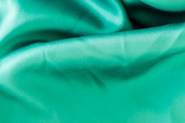 Textura material de tecido turquesa com espaço de cópia