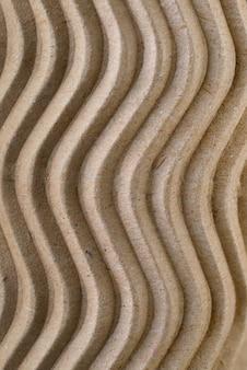 Textura ondulada de papelão reciclado de cor marrom