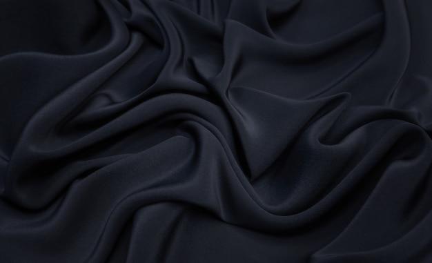 Textura ondulada de tecido de seda preta
