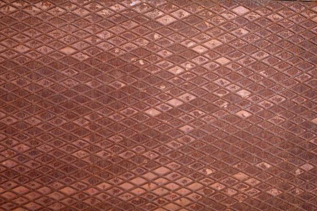 Textura ou fundo antigo de superfície ondulada de metal enferrujado