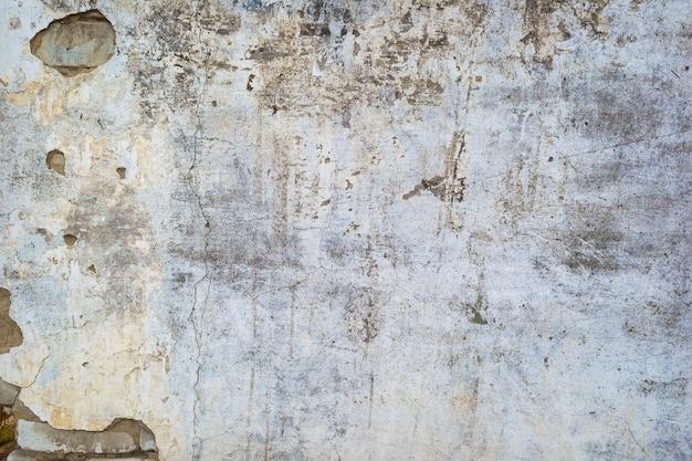 Textura ou fundo rachado da parede de concreto. fechar-se