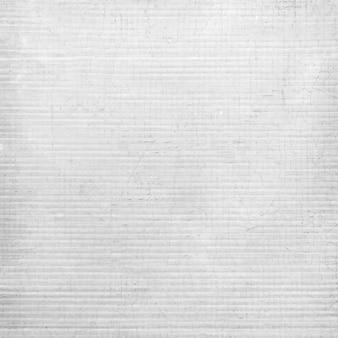Textura ou plano de fundo resistido branco da parede. fechar-se