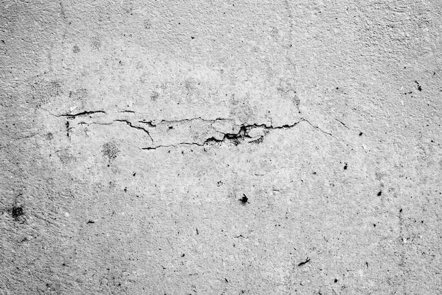 Textura, parede, fundo de concreto. fragmento de parede com fundo de arranhões e rachaduras