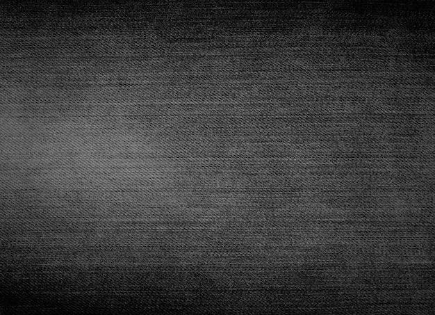 Textura preta da sarja de nimes, fundo das calças de brim, para o projeto