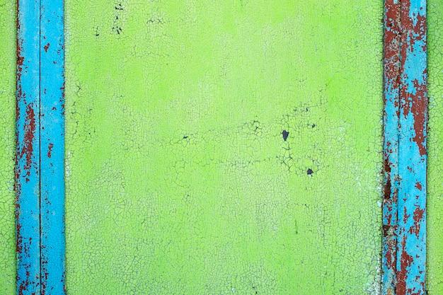 Textura rachada tinta velha, fundo verde brilhante com listras azuis verticais