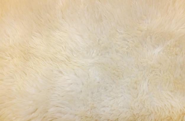 Textura sintética da cor do creme da pele para o fundo.