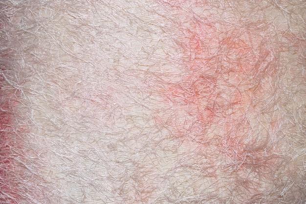 Textura sintética de tela rosa pastel e branca para o fundo