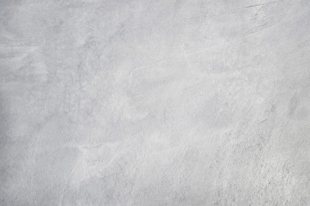 Textura suja velha, parede concreta do cimento da cor cinzenta branca com detalhe de estuque áspero e rachadura para o trabalho de arte do fundo e do projeto.