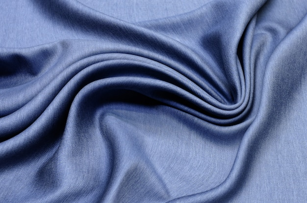 Textura, tecido de lã azul escuro com para costura de roupas.