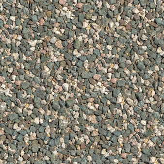 Textura tileable sem costura de superfície de granito esmagado multicolorido.