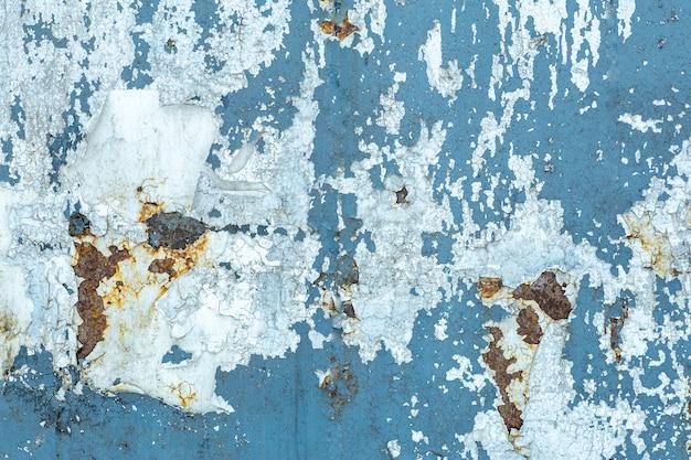 Textura velha da pintura da casca em um fundo de madeira da parede. padrão e textura da velha tinta seca e estuque em uma superfície áspera