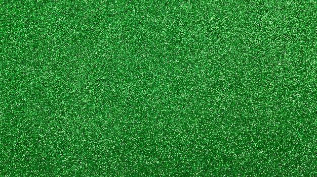 Textura verde do glitter para um fundo.