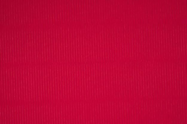 Textura vermelha do papel ondulado, uso para o fundo.