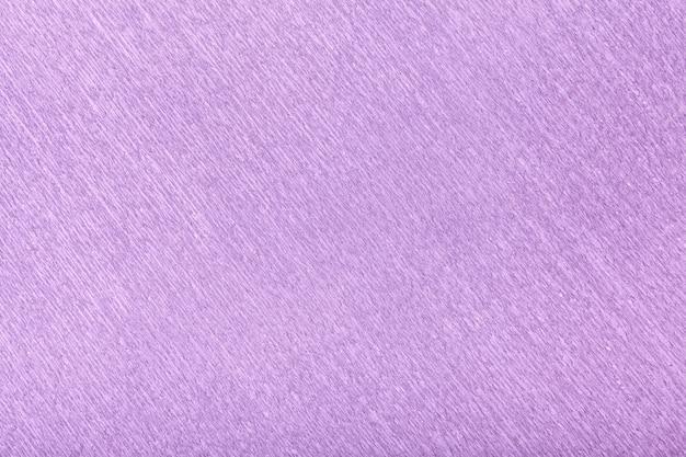 Textural do papel ondulado ondulado lilás, close up.