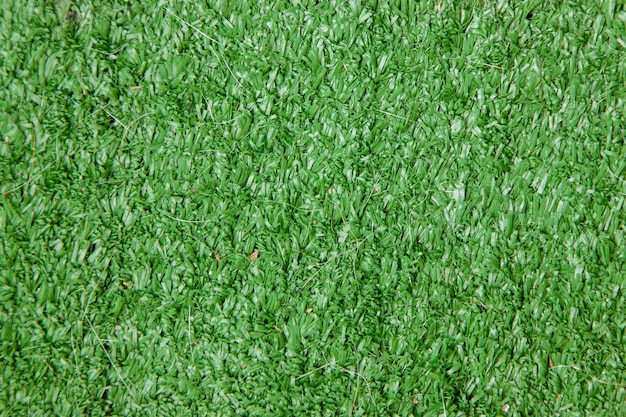 Texturas de campo de grama artificial verde e fundo a grama usada para jardim e campo de futebol