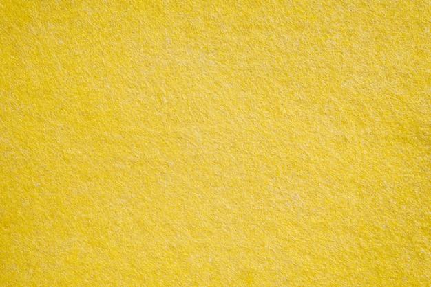 Texturas têxteis amarelas, fundo de close-up