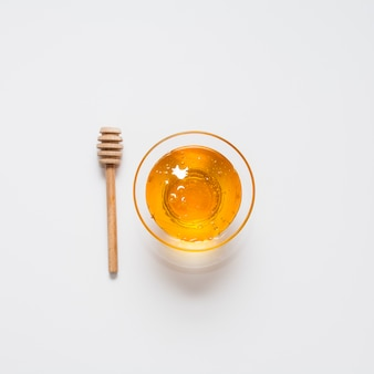 Tigela de vista superior cheia de mel orgânico