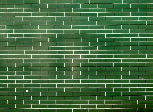 Tijolo de azulejos verdes.