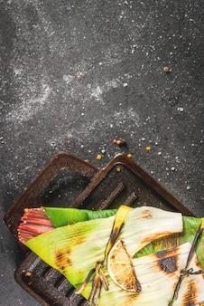 Tilápia assada na grelha em alho-poró