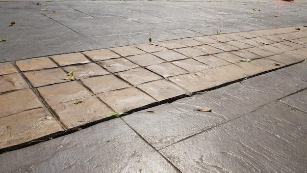 Tile ou piso térreo de tijolo decorativo uma estrada.