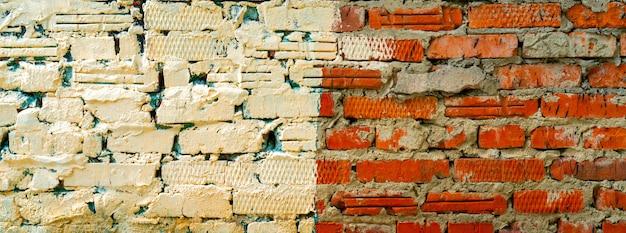 Tinta branca em uma parede de tijolo vermelho.