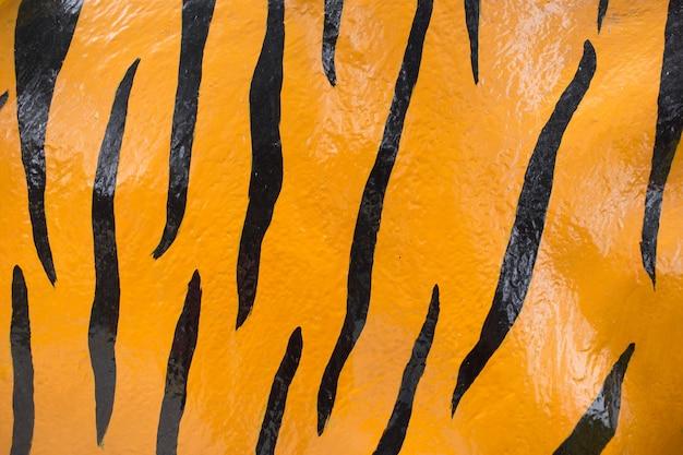 Tinta de pele de tigre em fundo de textura de concreto