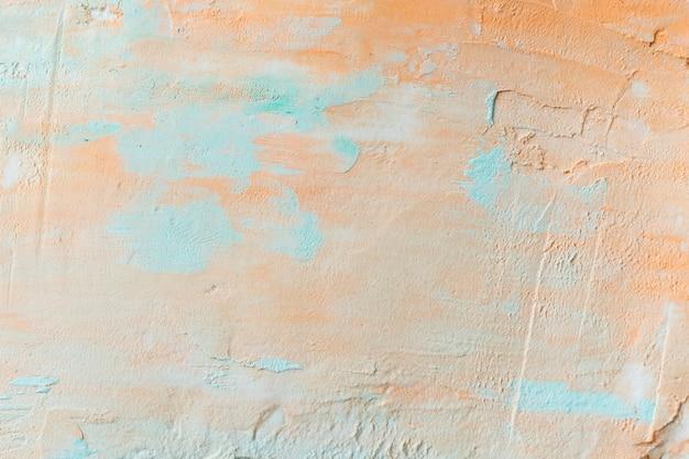Tinta laranja em uma parede de concreto