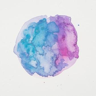 Tintas azuis e violetas em forma de círculo em papel branco