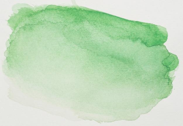 Tintas verdes na folha branca