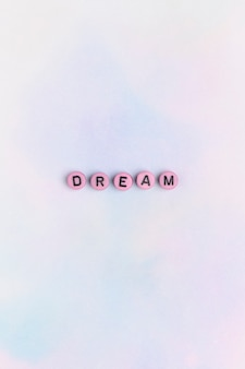 Tipografia de texto rosa dream em tons pastel