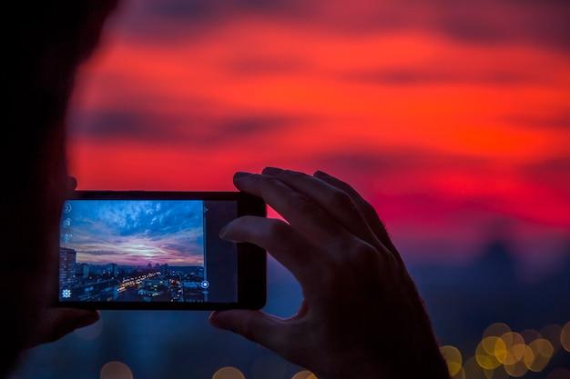 Tirar foto ao pôr do sol