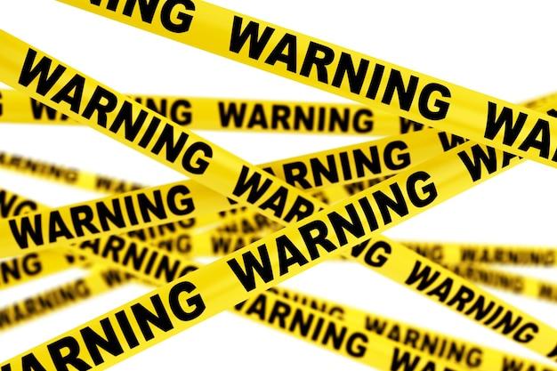 Tiras de fita amarela de advertência em um fundo branco
